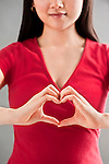Asian woman making heart sign