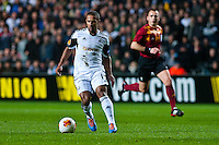 Swansea, UK. Thursday 20 February 2014<br /> Pictured: Wayne Routledge brings the ball forwards for Swansea<br /> Re: UEFA Europa League, Swansea City FC v SSC Napoli at the Liberty Stadium, south Wales, UK