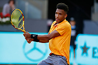 Felix Auger-Aliassime of Canada plays a forehand against Denis Shapovalov of Canada during day two of the Mutua Madrid Open at La Caja Magica on May 05, 2019 in Madrid, Spain. /NortePhoto.com