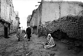 Kabul, Afghanistan<br /> November 2001<br /> <br /> Woman begging in an alley.