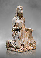 Gothic marble statue of Mary Magdelane (Magdelena) by Mestre de Pedralbes of Barcelona, 2nd half of 14th Century, from the cemetery of the cathedral of Barcelona.  National Museum of Catalan Art, Barcelona, Spain, inv no: MNAC  9797. Against a grey art background.