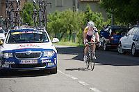 2013 Giro d'Italia.stage 13: Busseto - Cherasco..Lars Bak (DNK) driving down to the team car of DS Marc Wauters (BEL) to discuss tactics in the breakaway