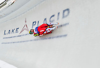 5 December 2014:  Thomas Steu and Lorenz Koller, sliding for Austria, bank into Curve 10 on their second run, ending the day with a 12th place finish and a combined 2-run time of 1:29.003 in the Men's Doubles Competition at the Viessmann Luge World Cup, at the Olympic Sports Track in Lake Placid, New York, USA. Mandatory Credit: Ed Wolfstein Photo *** RAW (NEF) Image File Available ***