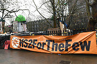'HS2 For The Few' banner during a protest against the construction of the HS2 railway line at Euston Square Gardens on 27th January 2021