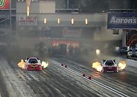 Oct. 27, 2012; Las Vegas, NV, USA: NHRA funny car driver Bob Tasca III (right) races alongside Jim Head during qualifying for the Big O Tires Nationals at The Strip in Las Vegas. Mandatory Credit: Mark J. Rebilas-
