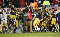PHILADELPHIA, PA - DEC 14, 2019: Somewhere in the free is Navy Midshipmen head coach Ken Niumatalolo being doused with gatorade after defeating Army at Lincoln Financial Field in Philadelphia, PA. The Midshipmen defeated Army 31-7. (Photo by Phil Peters/Media Images International)