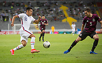 , MEXICO - : Sebastian Saucedo #10 of the United States attempts to dribble past Manuel Mayorga #3 of Mexico during a game between  and undefined at  on ,  in , Mexico.