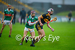 Michael Lenihan of Dr Crokes in possession ahead of Donal Hunt of Crotta O'Neills in the Senior County Hurling championship, round 2 game.