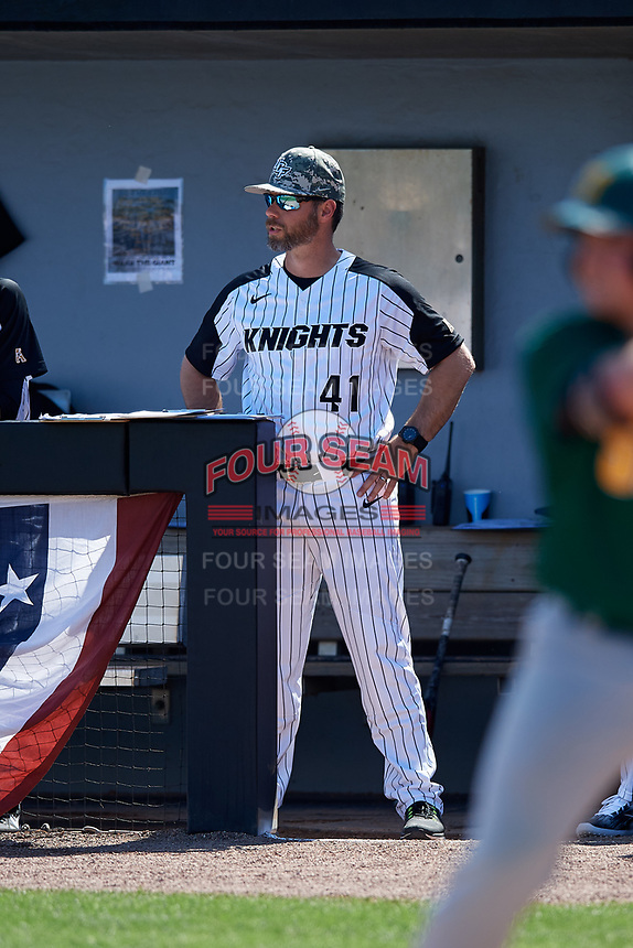 UCF Knights assistant coach Nick Otte (41) in the dugout during a game against the Siena Saints on February 17, 2019 at John Euliano Park in Orlando, Florida.  UCF defeated Siena 7-1.  (Mike Janes/Four Seam Images)