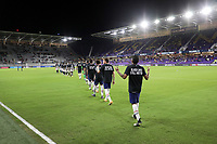 ORLANDO CITY, FL - JANUARY 31: USMNT march onto the field during a game between Trinidad and Tobago and USMNT at Exploria stadium on January 31, 2021 in Orlando City, Florida.