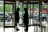 A member of West London Citizens talks to a doorman at the Hilton Hotel, Park Lane, during an unannounced visit to promote the organisation's Living Wage Campaign.