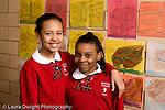 K-8 Parochial School Bronx New York Grade 4 portrait of two girls in hallway differing heights horizontal