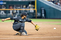 Vanderbilt Commodores third baseman Austin Martin (16) fields a ground ball against the Michigan Wolverines during Game 2 of the NCAA College World Series Finals on June 25, 2019 at TD Ameritrade Park in Omaha, Nebraska. Vanderbilt defeated Michigan 4-1. (Andrew Woolley/Four Seam Images)