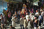 The Dussehra Festival is held in October or early November each year. At this time  Raghunathji (Lord Rama), the presiding Deity of the Kullu Valley, is brought from the Raghunath Temple to Dhalpur Maidan in Kullu. There are around 360 village devtas (gods) and they are carried down from each village to Kullu to pay homage to Lord Raghunathji and to attend the assembly of the gods.The festival celebrates the victory of good over evil, when Lord Rama defeated Ravana the demon king of Lanka. Here the local residents are carrying the murti of Vashisht who is not a god but the spiritual master (guru) of Lord Rama..Vashisht, Himachal Pradesh, India.