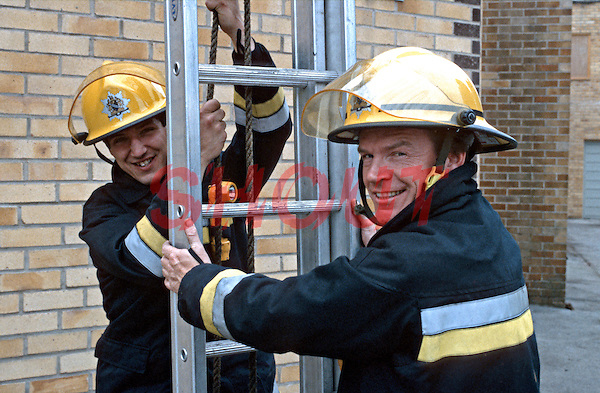 Firefighters pitching a ladder to gain access to fourth floor window. This image may only be used to portray the subject in a positive manner..©shoutpictures.com..john@shoutpictures.com