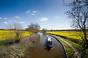 19/04/16 <br /> <br /> Surrounded by blue skies and spring sunshine a narrowboat passes fields of bright yellow rapeseed as it makes its way along the Trent and Mersey Canal near Swarkestone, Derbyshire.<br /> <br /> <br /> All Rights Reserved: F Stop Press Ltd. +44(0)1335 418365   +44 (0)7765 242650 www.fstoppress.com