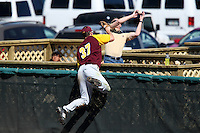 March 7, 2010:  Matt Faiman of the Central Michigan Chippewas attempts to catch a home run ball as it goes through a fans hands during game at Jay Bergman Field in Orlando, FL.  Central Michigan defeated Central Florida by the score of 7-4.  Photo By Mike Janes/Four Seam Images
