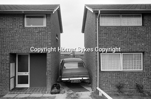 Milton Keynes 1977. New town built in Buckinghamshire, car squashed between two terraced houses. 1970s