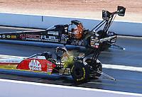 Apr 12, 2015; Las Vegas, NV, USA; NHRA top fuel driver Doug Kalitta (near lane) races alongside Spencer Massey during the Summitracing.com Nationals at The Strip at Las Vegas Motor Speedway. Mandatory Credit: Mark J. Rebilas-