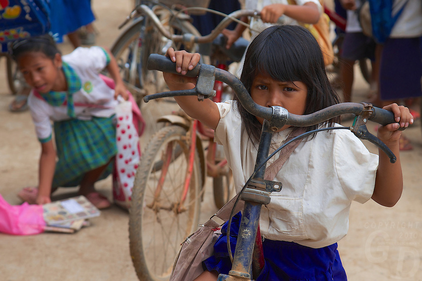 School is out a Young girl and her bike on Silk Island outside Phnom Penh, Cambodia. Home of the Traditional Khmer Silk production