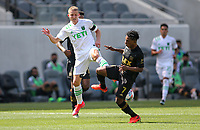 LOS ANGELES, CA - APRIL 17: Alex Ring #8 of Austin FC and Latif Blessing #7 of LAFC battle for a ball during a game between Austin FC and Los Angeles FC at Banc of California Stadium on April 17, 2021 in Los Angeles, California.