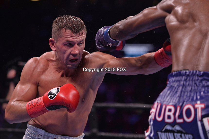 """BROOKLYN, NY - DECEMBER 22: (L-R) Russian boxer Matt Korobov and american boxer Jermall Charlo fight for the WBC Interim Middleweight Championship during the Fox Sports and Premier Boxing Champions  December 22 """"PBC on Fox"""" Fight Night at the Barclays Center on December 22, 2018 in Brooklyn, New York. (Photo by Anthony Behar/Fox Sports/PictureGroup)"""