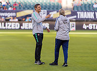 PHILADELPHIA, PA - AUGUST 29: Francisco Neto of Portugal and Jill Ellis of the United States talk on the field prior to a game between Portugal and the USWNT at Lincoln Financial Field on August 29, 2019 in Philadelphia, PA.