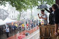 Jeremy making the pre ride announcment during a brief but severe rain downpour