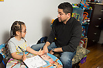 Early Intervention ABA (Applied Behavior Analysis) therapist working with boy at home<br /> ABA is often successful working with children with autism and spectrum disorders