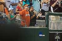 Marlins Man sits front row during a College World Series Finals game between the Coastal Carolina Chanticleers and Arizona Wildcats at TD Ameritrade Park on June 28, 2016 in Omaha, Nebraska. (Brace Hemmelgarn/Four Seam Images)