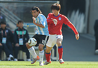 Forward Carlos Tevez shields and distributes ball, building the Argentina attack. Argentina defeated South Korea, 4-1, in both teams' second match of play in Group B of the 2010 FIFA World Cup. The match was played at Soccer City in Johannesburg, South Africa June 17th.