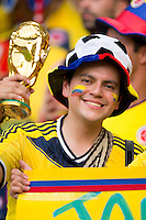 A Columbia fan with a fake world cup trophy
