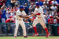 Philadelphia Phillies outfielder Hunter Pence #3 is congratulated by third base coach Juan Samuel #12 during the Major League Baseball game against the Pittsburgh Pirates on June 28, 2012 at Citizens Bank Park in Philadelphia, Pennsylvania. The Pirates defeated the Phillies 5-4. (Andrew Woolley/Four Seam Images).