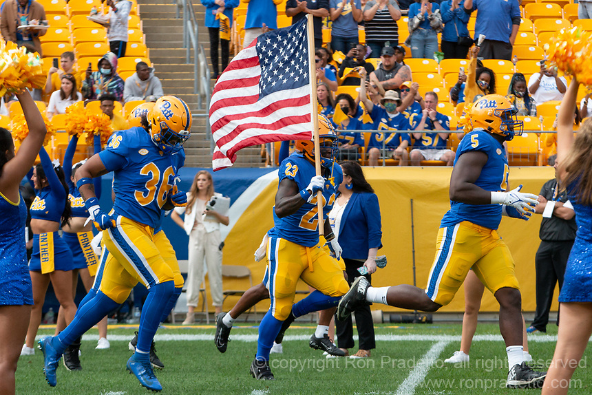 Pitt running back Todd Sibley waves the American flag as the Pitt football team takes the field. The Pitt Panthers defeated the New Hampshire Wildcats 77-7 at Heinz Field, Pittsburgh, Pennsylvania on September 25, 2021.