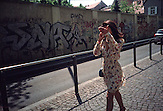(In)famous Croatian actress Dolores Lambasa hiding her face while talking on the cell phone in Varsavska street.