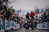Ivan Garcia Cortina (ESP/Bahrain-Merida) & Tom Devriendt (BEL/Wanty-Groupe Gobert) leading coming over the Oude Kwaremont cobbles<br /> <br /> 102nd Ronde van Vlaanderen 2018 (1.UWT)<br /> Antwerpen - Oudenaarde (BEL): 265km