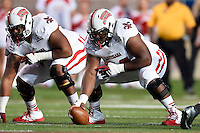 Louisiana Lafayette center Terry Johnson (72), on right, set to snap the ball during first half of an NCAA football game, Tuesday, October 14, 2014 in San Marcos, Tex. Louisiana Lafayette leads 21-3 at the halftime. (Mo Khursheed/TFV Media via AP Images)
