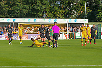 9th October 2021;  VBS Community Stadium, Sutton, London; EFL League 2 football, Sutton United versus Port Vale; Alistair Smith (29) of Sutton United slides into the tackle