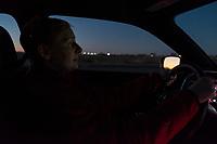 Heidi Wickersham drives away from White Sands National Monument as the sun sets near Alamogordo, New Mexico, USA, on Fri., Dec. 29, 2017.
