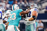 Miami Dolphins defensive tackle Ndamukong Suh (93) and Dallas Cowboys guard Zack Martin (70) in action during the pre-season game between the Miami Dolphins and the Dallas Cowboys at the AT & T stadium in Arlington, Texas.