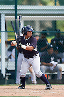 GCL Yankees East catcher Ronaldo Suarez (27) at bat during a game against the GCL Pirates on August 15, 2016 at the Pirate City in Bradenton, Florida.  GCL Pirates defeated GCL Yankees East 5-2.  (Mike Janes/Four Seam Images)