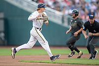 Michigan Wolverines shortstop Jack Blomgren (2) makes a throw to first base against the Vanderbilt Commodores during Game 2 of the NCAA College World Series Finals on June 25, 2019 at TD Ameritrade Park in Omaha, Nebraska. Vanderbilt defeated Michigan 4-1. (Andrew Woolley/Four Seam Images)