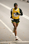 Meb Keflezighi runs through Central Park while competing in the 2008 Men's Olympic Trials Marathon on November 3, 2007 in New York, New York.  The race began at 50th Street and Fifth Avenue and finished in Central Park.  Hall won the race with a time of 2:09:02.