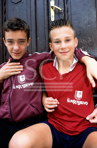 Sarajevo, Bosnia. Boys wearing local football team shirts.