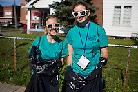 """Sally Finkel, left, and Molly Baumann pose for a photo as they pick up trash in the Hawthorne neighborhood during """"Circle the City with Service,"""" the Kiwanis Circle K International's 2015 Large Scale Service Project, on Wednesday, June 24, 2015, in Indianapolis. (Photo by James Brosher)"""