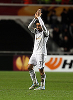 Swansea, UK. Thursday 20 February 2014<br /> Pictured L-R: Swansea player Leon Britton thanks home supporters<br /> Re: UEFA Europa League, Swansea City FC v SSC Napoli at the Liberty Stadium, south Wales, UK