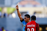 July 16th 2021; Orlando, Florida, USA; Referee Bryan Lopez shows a yellow card during the Concacaf Gold Cup match between Guadeloupe and Jamaica on July 16, 2021 at Exploria Stadium in Orlando, Fl.