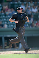 Home plate umpire Evin Johnson works a game between the Greenville Drive and West Virginia Power on Sunday, May 19, 2019, at Fluor Field at the West End in Greenville, South Carolina. Greenville won, 8-4. (Tom Priddy/Four Seam Images)