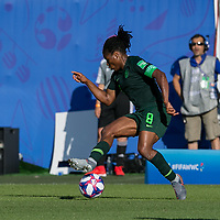 GRENOBLE, FRANCE - JUNE 22: Desire Oparanozie #9 dribbles at midfield during a game between Panama and Guyana at Stade des Alpes on June 22, 2019 in Grenoble, France.