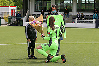 Goalkeeper Louise Van Den Bergh (1) of OHL is presented by Marijke Das a match shirt and flowers for her service to the club over the years as a player before a female soccer game between Oud Heverlee Leuven and AA Gent Ladies on the 9 th matchday of play off 1 in the 2020 - 2021 season of Belgian Womens Super League , saturday 22 nd of May 2021  in Heverlee , Belgium . PHOTO SPORTPIX.BE | SPP | SEVIL OKTEM